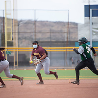 Rehoboth shortstop Ashley Skeets, center, fields a grounder and tags Thoreau's Amira Long out before she reaches third base Thursday at Ford Canyon Park in Gallup.