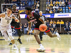 Dec 14, 2019; Morgantown, WV, USA; Nicholls State Colonels guard Andre Jones (13) drives while defended by West Virginia Mountaineers guard Jordan McCabe (5) during the first half at WVU Coliseum. Mandatory Credit: Ben Queen-USA TODAY Sports