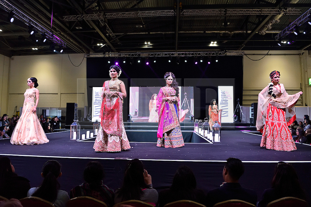 © Licensed to London News Pictures. 27/03/2016. Models on a catwalk stage wearing bridal dresses at the Asian Bride Live Wedding Show featuring fashion, beauty and services for brides to be. London, UK. Photo credit: Ray Tang/LNP