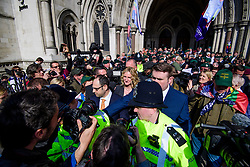 © Licensed to London News Pictures.28/03/2017.London, UK. CLAIRE BLACKMAN (C), wife of Sergeant Alexander Blackman, surrounded by media and security as she leaves the Royal Courts of Justice in London, where a judge reduced the sentence for Sgt Blackman's manslaughter charge, meaning he will be free within weeks..Photo credit: Ben Cawthra/LNP