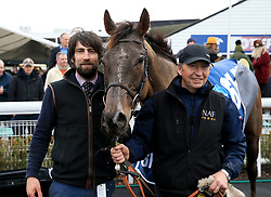 Trainer Christian Williams (left) poses with his horse Potters Corner after winning the Marstons 61 Deep Midlands Grand National race at Uttoxeter Racecourse.