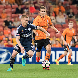 BRISBANE, AUSTRALIA - OCTOBER 7: Oliver Bozanic of the Victory and Thomas Kristensen of the Roar compete for the ball during the round 1 Hyundai A-League match between the Brisbane Roar and Melbourne Victory at Suncorp Stadium on October 7, 2016 in Brisbane, Australia. (Photo by Patrick Kearney/Brisbane Roar)