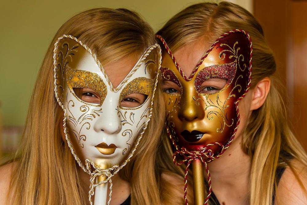 Girl with carnival mask, Cedar City, Utah USA