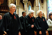 """Illinois Supreme Court Justices (L to R) Mary Jane Theis, Mary Ann G. McMorrow (retired) and Anne M. Burke lead a procession of fellow judges, law school professors and members of the Catholic Lawyers Guild during the 78th Annual Votive Mass of the Holy Spirit, or """"Red Mass"""" at Holy Name Cathedral in Chicago. September 30, 2012 l Brian J. Morowczynski~ViaPhotos..For use in a single edition of Catholic New World Publications, Archdiocese of Chicago. Further use and/or distribution may be negotiated separately. Contact ViaPhotos at 708-602-0449 or email brian@viaphotos.com."""
