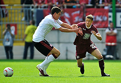 24.07.2010, Fritz-Walter Stadion, Kaiserslautern, GER, 1. FBL, Friendly Match, 1.FC Kaiserslautern vs FC Liverpool, im Bild Ivo ILICEVIC (Kaiserslauern #22 KRO) im Laufduell mit Martin KELLY (Liverpool #2), EXPA Pictures © 2010, PhotoCredit: EXPA/ nph/  Roth+++++ ATTENTION - OUT OF GER +++++ / SPORTIDA PHOTO AGENCY