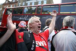 14 September 2017 -  UEFA Europa League (Group H) - Arsenal v FC Koln - An FC Koln fan chants as a London double decker bus passes by  - Photo: Mark Leech/Offside