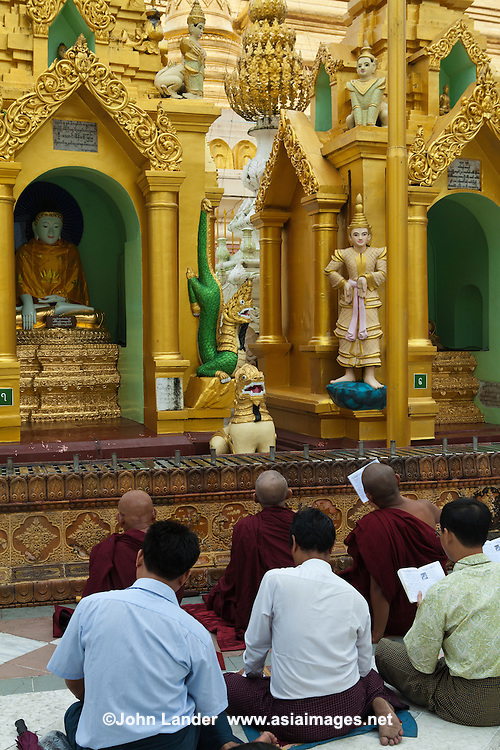 When Myanmar Buddhists go to the pagoda, they know in their hearts that they are treading the noble path to that state where human nature will have a fair chance to manifest itself in deeds of generosity, loving kindness and compassion for fellow beings..The guiding force is faith in one's own karmic deeds. For example, contemplation of the infinite compassion of Buddha, as one makes one's way to Shwedagon's great stupa, is a good karmic deed. The pilgrim, on his way up the steps of the pagoda, buys flowers, candles, coloured flags and streamers. They are to be offered in honour of the great stupa wherein are enshrined the relics of Buddha. This act is the act of dana, or giving, an important aspect of Buddhist teaching.