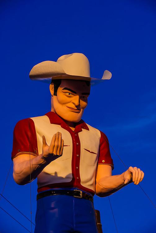 """Muffler Man"" a huge cowboy atop John's Used Cars, Historic Route 66, Gallup, New Mexico USA."