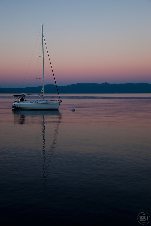 """""""Sailboat and Sunset on Lake Tahoe 2"""" - This serene sunset was photographed from the West shore of Lake Tahoe, California."""