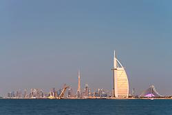Skyline of Dubai waterfront with Burj al Arab Hotel in United Arab Emirates