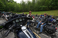 "Tracey Powell of Brookline, NH and Bruce Yowell of Gettysburg, PA line up with fellow riders for the ""Ride to the Sky"" on Thursday morning at Laconia Harley in Meredith.  (Karen Bobotas/for the Laconia Daily Sun)"