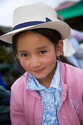 Girl at weekly produce market, Gualaceo (near Cuenca), Ecuador, South America