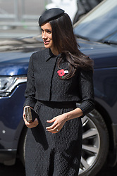 Meghan Markle, wearing a black Emilia Wickstead jacket and skirt and a Philip Treacy hat,  attends the Anzak Day service at Westminster Abbey in London on April 25, 2018.
