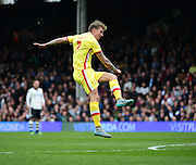 MK Dons Carl Baker takes a shot during the Sky Bet Championship match between Fulham and Milton Keynes Dons at Craven Cottage, London, England on 2 April 2016. Photo by Jon Bromley.