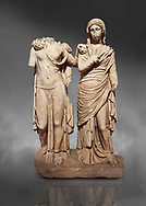 Roman statue of two women; Marble. Perge. 2nd century AD. Inv 3271. Antalya Archaeology Museum; Turkey. Against a grey background .<br /> <br /> If you prefer to buy from our ALAMY STOCK LIBRARY page at https://www.alamy.com/portfolio/paul-williams-funkystock/greco-roman-sculptures.html . Type -    Antalya     - into LOWER SEARCH WITHIN GALLERY box - Refine search by adding a subject, place, background colour, museum etc.<br /> <br /> Visit our ROMAN WORLD PHOTO COLLECTIONS for more photos to download or buy as wall art prints https://funkystock.photoshelter.com/gallery-collection/The-Romans-Art-Artefacts-Antiquities-Historic-Sites-Pictures-Images/C0000r2uLJJo9_s0