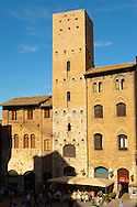 Medieval Towers around Plazza Duomo - San Gimignano - Italy .<br /> <br /> Visit our ITALY PHOTO COLLECTION for more   photos of Italy to download or buy as prints https://funkystock.photoshelter.com/gallery-collection/2b-Pictures-Images-of-Italy-Photos-of-Italian-Historic-Landmark-Sites/C0000qxA2zGFjd_k<br /> If you prefer to buy from our ALAMY PHOTO LIBRARY  Collection visit : https://www.alamy.com/portfolio/paul-williams-funkystock/sangimignano.html