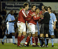 Photo. Glyn Thomas. <br /> Coventry City v Nottingham Forest. <br /> Coca Cola Championship. 06/04/2005.<br /> Nottingham Forest players surround referee Andy D'Urso (second from R) after he awarded a penalty to Coventry for a handball. Louis-Jean (C) was also shown a yellow for manhandling the referee