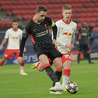 Jordan Henderson (L) of Liverpool FC and Dani Olmo (R) of RB Leipzig fight for the ball during the UEFA Champions League Round of 16 First Leg Football match between RB Leipzig and Liverpool FC in Budapest, Hungary on Feb. 16, 2021. ATTILA VOLGYI