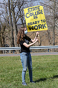Penn State sophomore Abbie La Porta holds a sign at a Sunrise Movement rally outside of Congressman Fred Keller's district office in Selinsgrove, Pennsylvania on April 7, 2021. Sunrise Movement groups from Lewisburg and State College rallied outside of Keller's office to demand that he sign the Good Jobs for All Congressional Pledge.