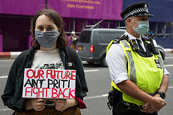 A Kill The Bill activist attends a rally organised by Doctors in Unite outside the Department of Health and Social Care on 5th July 2021 in London, United Kingdom. The rally was organised to mark the 73rd birthday of the National Health Service and in protest against the sale of one of the UK's biggest GP practice operators to the US health insurance group Centene Corporation.
