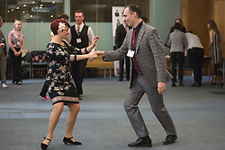 © Licensed to London News Pictures. 23/02/2015. London, England. Pictured: Jenny Thomas (left). MPs attend a dance class with members of Dance UK and Lindy Hop dancers. Dance UK launches the 2015 Dance Manifesto with a beginners' social dance class hosted by the All Party Parliamentary Dance Group for all MPs at Portcullis House and led by teacher Jenny Thomas, charleston choreographer for the BBC's Strictly Come Dancing with Strictly professional dancer Robin Windsor. Photo credit: Bettina Strenske/LNP