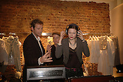 GAWAINE RAINEY AND JASMINE GUINNESS, Party to Celebrate opening of New Diesel Store on 130 Bond St.  at store and afterwards at Victoria House, Bllomsbury Sq. 18 May 2006. ONE TIME USE ONLY - DO NOT ARCHIVE  © Copyright Photograph by Dafydd Jones 66 Stockwell Park Rd. London SW9 0DA Tel 020 7733 0108 www.dafjones.com