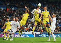 MADRID, SPAIN - APRIL 04:  Cristiano Ronaldo of Real Madrid heads the ball during the UEFA Champions League quarter-final second leg match between Real Madrid and APOEL FC at Bernabeu on April 4, 2012 in Madrid, Spain.  (Photo by Manuel Queimadelos Alonso/Getty Images)