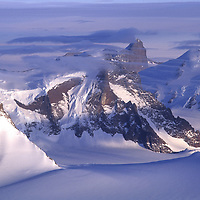 ANTARCTICA, Queen Maud Land. Kong Olav Fjell (L) and Gessnertind (bkg.), in Muhlig-Hoffman Mts.