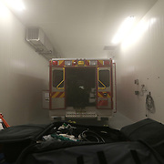 AeroClave founder Dr. Ronald Brown decontaminates a rescue vehicle at his office in Winter Park, Florida on Friday, Oct. 10, 2014. Viruses with similar characteristics to Ebola have been tested with positive results that show the pathogens can be erased. The Winter Park Fire/Rescue organization now has three ambulances equipped with self contained, built-in decontamination units – coming in the wake of an international Ebola virus scare. The units feature pressurized pumps, which release a decontamination mist inside the patient area of the ambulance. It takes about 15 minutes for the mist to cover all the surface area inside and break the chain of infection. In other instances, such as seen here, rescue vehicles and safety equipment can be brought into AeroClave and thoroughly decontaminated in approximately 35 minutes. (AP Photo/Alex Menendez)