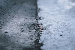 THEMENBILD - Split liegt zum Schutz vor Glatteis auf einem Weg, der am Rande noch Schnee und Eis bedeckt ist, aufgenommmen am 10. Februara 2021 in Kaprun, Oesterreich // Split lies on a path, which is still covered with snow and ice at the edge, to protect it from black ice, in Kaprun, Austria on 2021/02/10. EXPA Pictures © 2021, PhotoCredit: EXPA/Stefanie Oberhauser