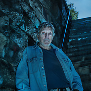 """William Peter Blatty, an Academy Award winning American writer and filmmaker, stands on the stairs he made infamous in his best know work - the thriller """"€œThe Exorcist."""""""