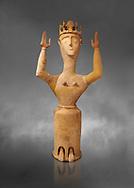 Minoan Postpalatial terracotta  goddess statue with raised arms and crown,  Karphi Sanctuary 1200-1100 BC, Heraklion Archaeological Museum, grey background. <br /> <br /> The Goddesses are crowned with symbols of earth and sky in the shapes of snakes and birds, describing attributes of the goddess as protector of nature. .<br /> <br /> If you prefer to buy from our ALAMY PHOTO LIBRARY  Collection visit : https://www.alamy.com/portfolio/paul-williams-funkystock/minoan-art-artefacts.html . Type -   Heraklion   - into the LOWER SEARCH WITHIN GALLERY box. Refine search by adding background colour, place, museum etc<br /> <br /> Visit our MINOAN ART PHOTO COLLECTIONS for more photos to download  as wall art prints https://funkystock.photoshelter.com/gallery-collection/Ancient-Minoans-Art-Artefacts-Antiquities-Historic-Places-Pictures-Images-of/C0000ricT2SU_M9w