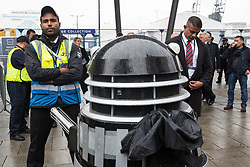 London, UK. 14th September, 2021. A Stop The Arms Fair activist operating a Dalek tries to gain access to ExCeL London on the first day of the DSEI 2021 arms fair. Activists from a range of different groups have been protesting outside the venue for one of the world's largest arms fairs for over a week.