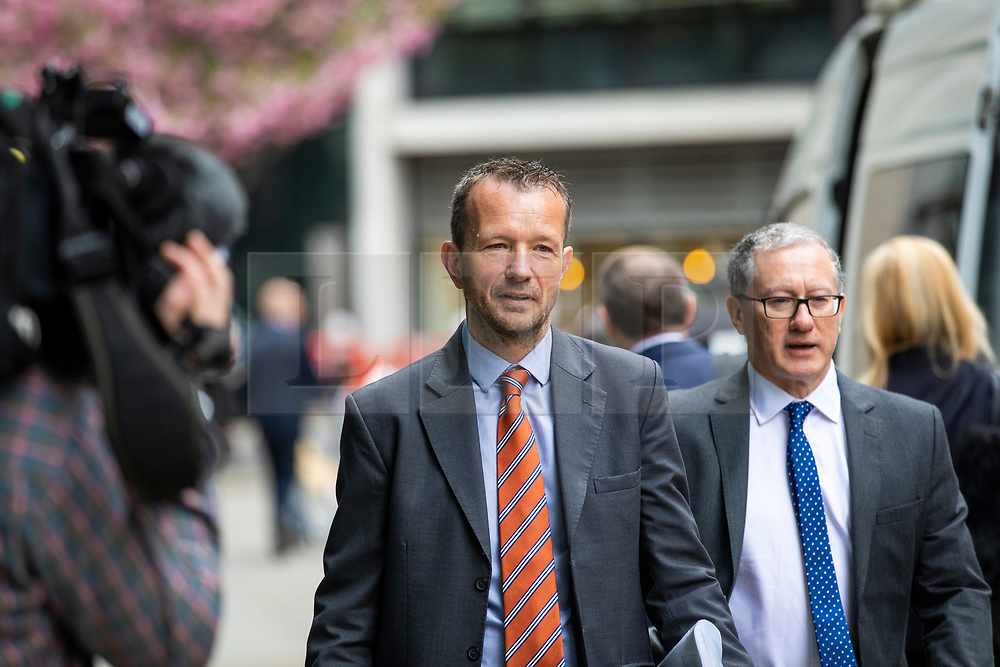 © Licensed to London News Pictures. 23/04/2018. London, UK. Jonathan Munro, Chief Newsgatherer at the BBC, arrives at the Rolls Building of the High Court in London where Sir Cliff Richard is claiming damages against the BBC for loss of earnings. The 77-year-old singer is suing the corporation after his home in Sunningdale, Berkshire was raided following allegations of sexual assault made to Metropolitan Police. Photo credit: Rob Pinney/LNP