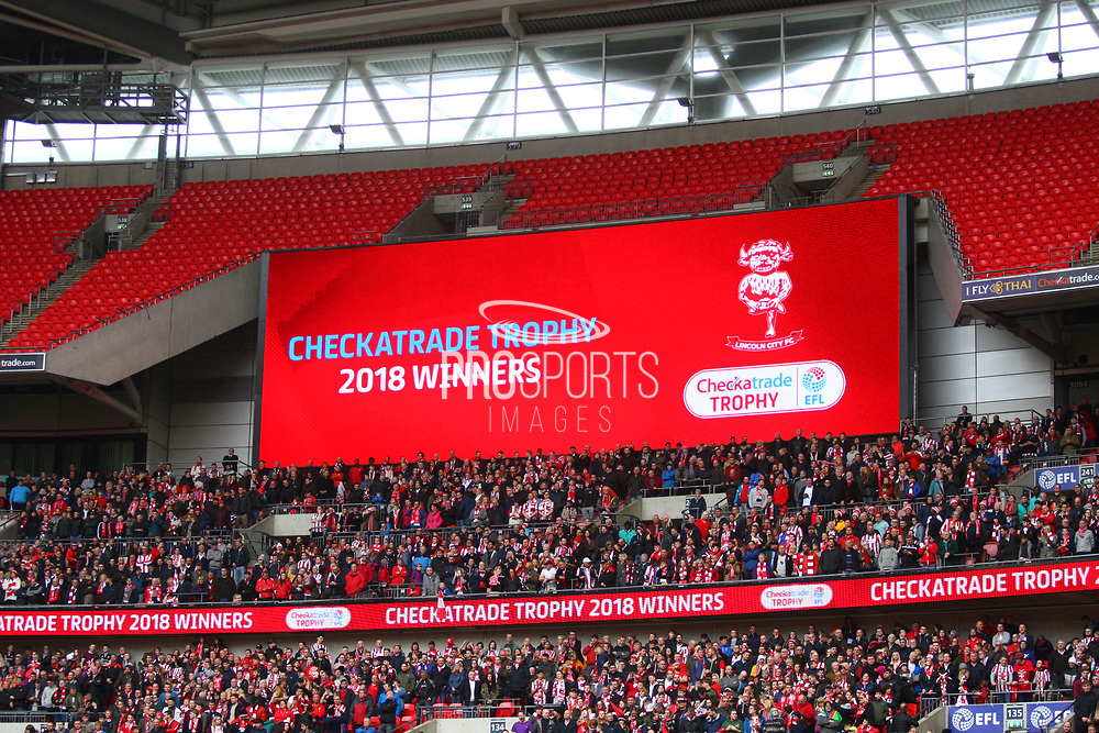 The scoreboard shows EFL Trophy winners Lincoln City during the EFL Trophy Final match between Lincoln City and Shrewsbury Town at Wembley Stadium, London, England on 8 April 2018. Picture by John Potts.