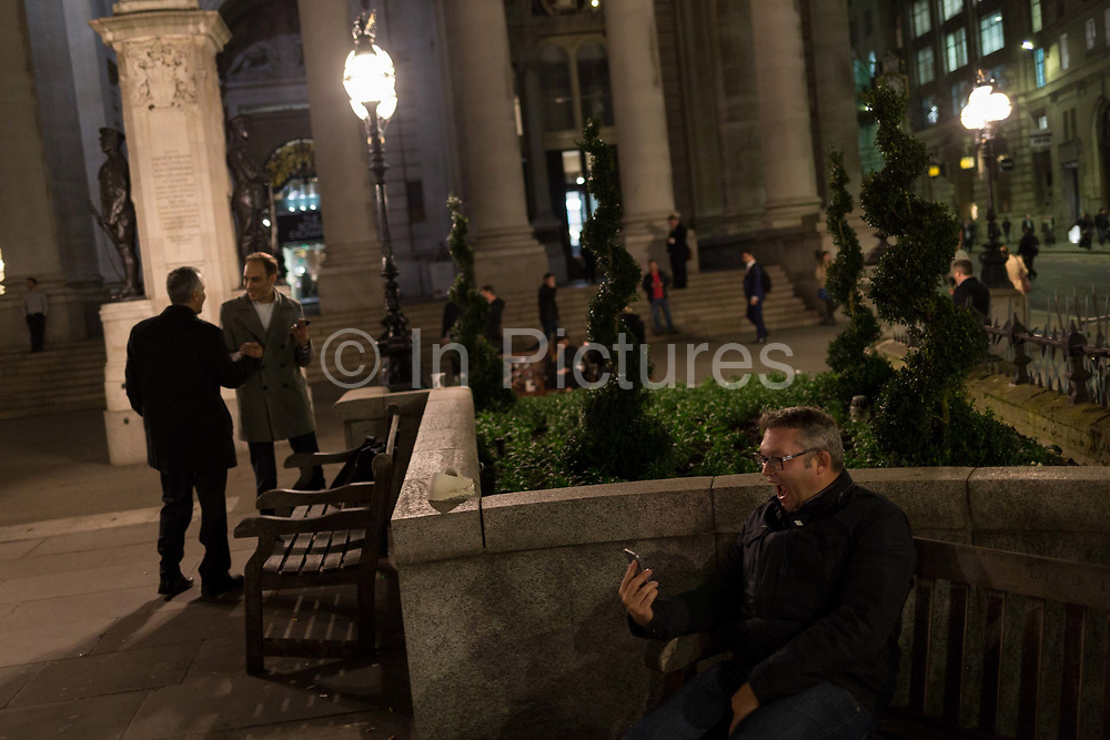 A man pulls faces during a live stream with family amid the bustle of Cornhill, in the Square Mile, the heart of the capitals historical financial district, on 2nd October 2017, in the City of London, England.