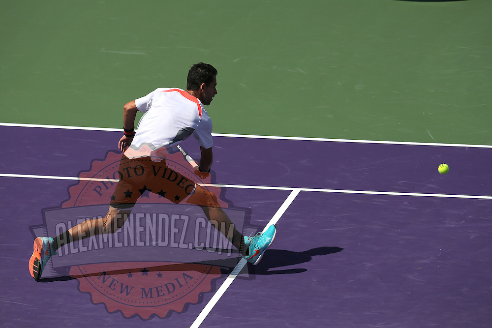 Santiago Giraldo of Columbia returns a serve from Andy Murray of Great Britain during their match at the Miami Open tennis tournament on Sunday, March 29, 2015 in Key Biscayne, Florida. (AP Photo/Alex Menendez)