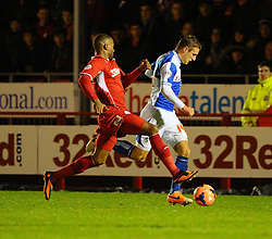 Bristol Rovers' Lee Brown is chased by Crawley Town's Emile Sinclair - Photo mandatory by-line: Seb Daly/JMP - Tel: Mobile: 07966 386802 08/01/2014 - SPORT - FOOTBALL - Broadfield Stadium - Crawley - Crawley Town v Bristol Rovers - FA Cup - Replay
