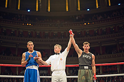 © Licensed to London News Pictures. London, UK  07/10/2011. JOEL KIRBY, Royal Navy (Right) is announced as the winner against DAVIS FEARBER, US Naval Academy (Left) .  Members of the UK and US Armed Forces take part in the Royal Albert Hall cup boxing match. This is the first time a boxing event has taken place in the historic venue following a court ruling banning the use of the hall for boxing and wrestling in 1999. The Court of Appeal subsequently overturned the decision earlier this year. The venue has hosted some of the greatest names in British boxing including Sir Henry Cooper, Frank Bruno, Lennox Lewis and Prince Naseem Hamed. Photo credit: Ben Cawthra/LNP