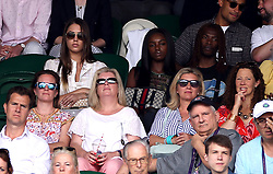 Amber Le Bon (top left), Leomie Anderson and Lancey Foux (back row right) in the stands on centre court on day one of the Wimbledon Championships at the All England Lawn Tennis and Croquet Club, Wimbledon.