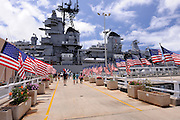 USA flags line the approach to the USS Missouri, permanently berthed at the Battleship Missouri Memorial, Pearl Harbour, Hawaii.