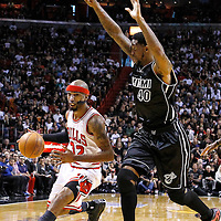 29 January 2012: Chicago Bulls shooting guard Richard Hamilton (32) drives past Miami Heat power forward Udonis Haslem (40) during the Miami Heat 97-93 victory over the Chicago Bulls at the AmericanAirlines Arena, Miami, Florida, USA.