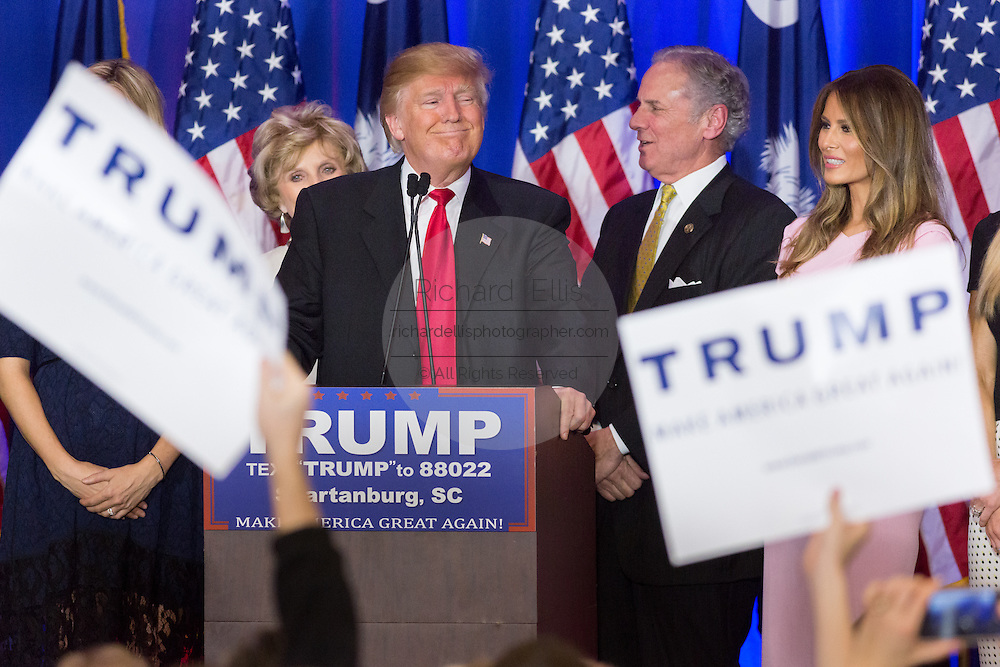 Billionaire and GOP presidential candidate Donald Trump acknowledges cheering supporters alongside wife Melania, daughter Ivanka and Lt. Gov. Henry McMasters as they celebrate victory in the South Carolina Republican primary February 20, 2016 in Spartanburg, South Carolina, USA .