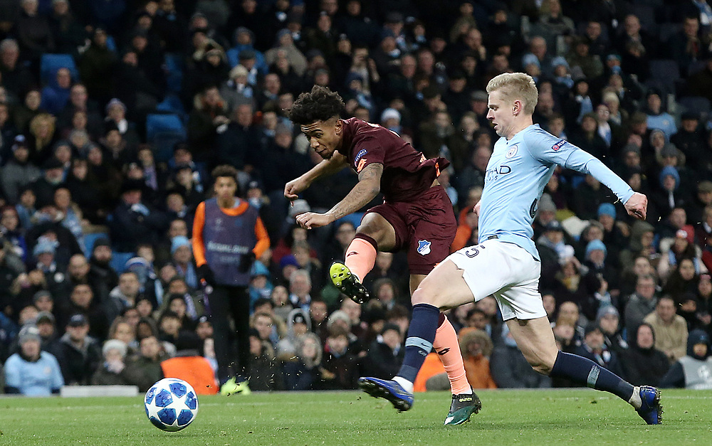 1899 Hoffenheim's Reiss Nelson shoots despite the attentions of Manchester City's Oleksandr Zinchenko<br /> <br /> Photographer Rich Linley/CameraSport<br /> <br /> UEFA Champions League Group F - Manchester City v TSG 1899 Hoffenheim - Wednesday 12th December 2018 - The Etihad - Manchester<br />  <br /> World Copyright © 2018 CameraSport. All rights reserved. 43 Linden Ave. Countesthorpe. Leicester. England. LE8 5PG - Tel: +44 (0) 116 277 4147 - admin@camerasport.com - www.camerasport.com