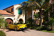 Luxury, stylish, winter home and yellow drop head convertible Chevrolet Camaro R5 sports car, Captiva Island, Florida, USA