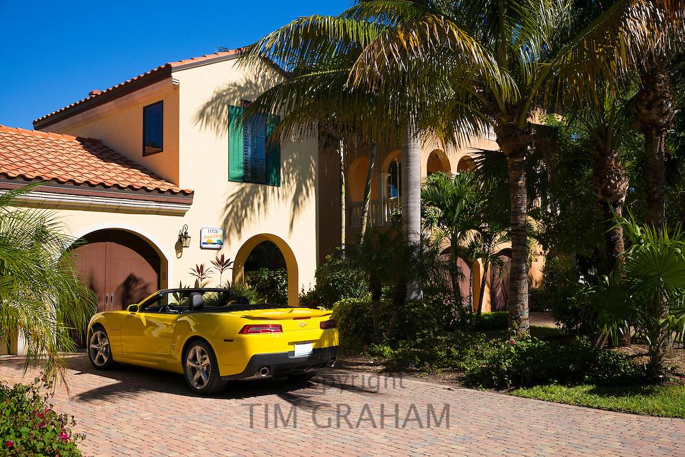 Luxury, stylish, winter home and yellow drop head convertible Chevrolet Camaro R5 sports car, Captiva Island, Florida, USA