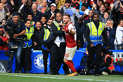 17 September 2017 -  Premier League - Chelsea v Arsenal - Shkodran Mustafi of Arsenal celebrates a disallowed goal as stewards rush past to apprehend a fan ran that ran onto the pitch - Photo: Marc Atkins/Offside