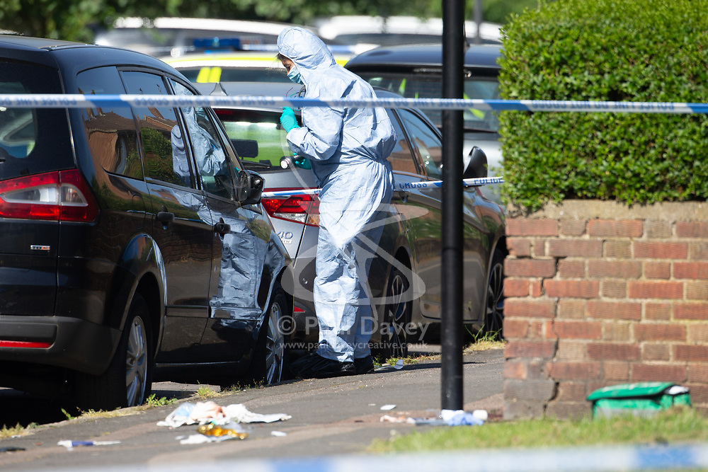 A forensics investigator at the scene at the intersection of Cole Crescent and Scott Crescent in Harrow where a 17-year-old was stabbed on the night of Sunday 10th June, leaving him in critical condition. June 11 2018.