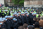 London, UK. Saturday 1st June 2013. Demontrators in Westminster to protest against fascism and the BNP who held a small rally nearby. Unite Against Fascism organised this counter-demonstration in which police had to keep both sides apart. Here they have formed a line of people but are pushed back by the police.