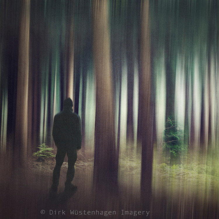 Man entering a forest - abstract manipulated photograph